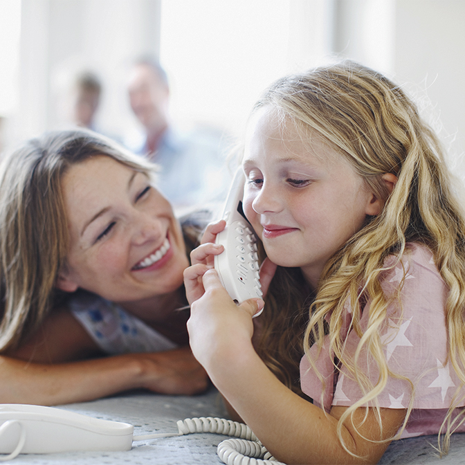 Child talking on landline