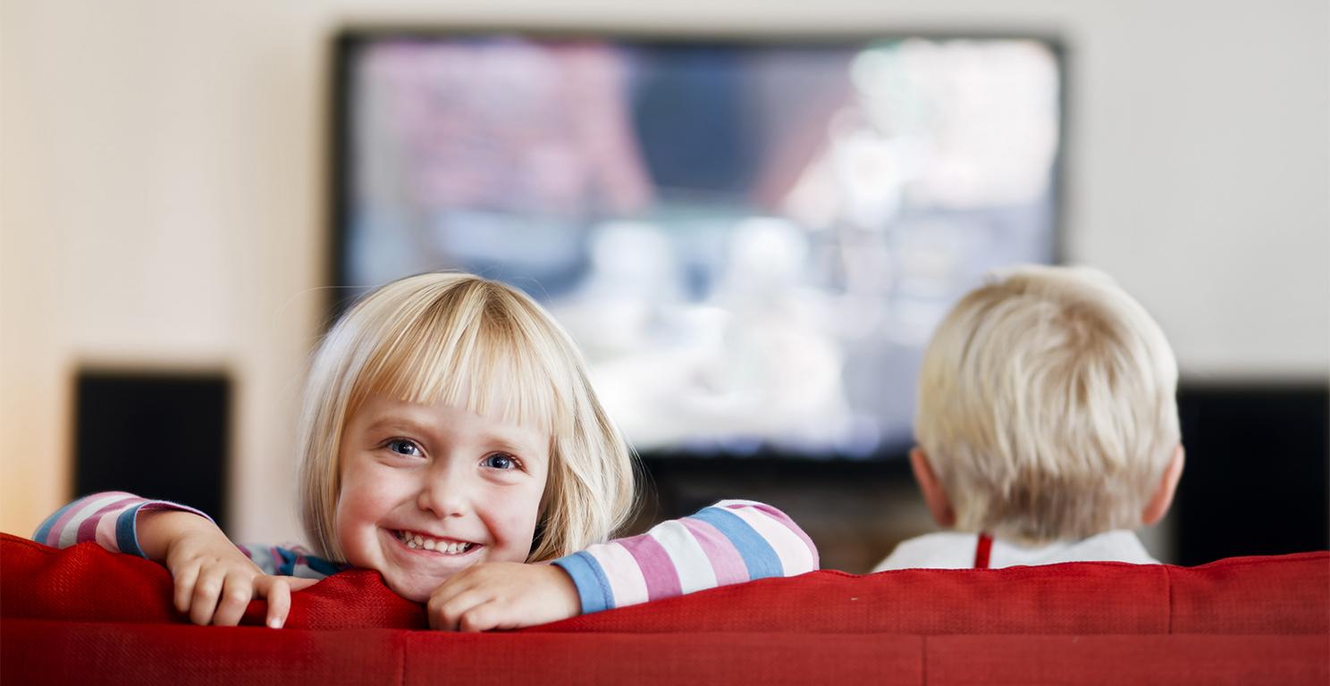 Happy Children watching Television.