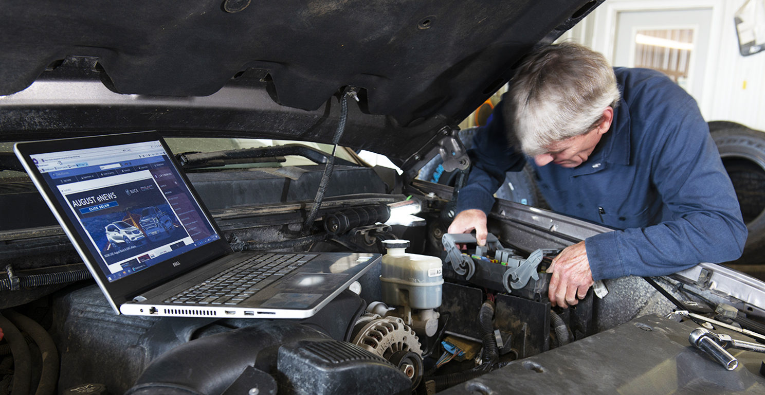 mechanic working with internet