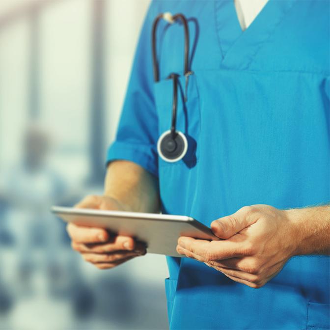 nurse looking at tablet